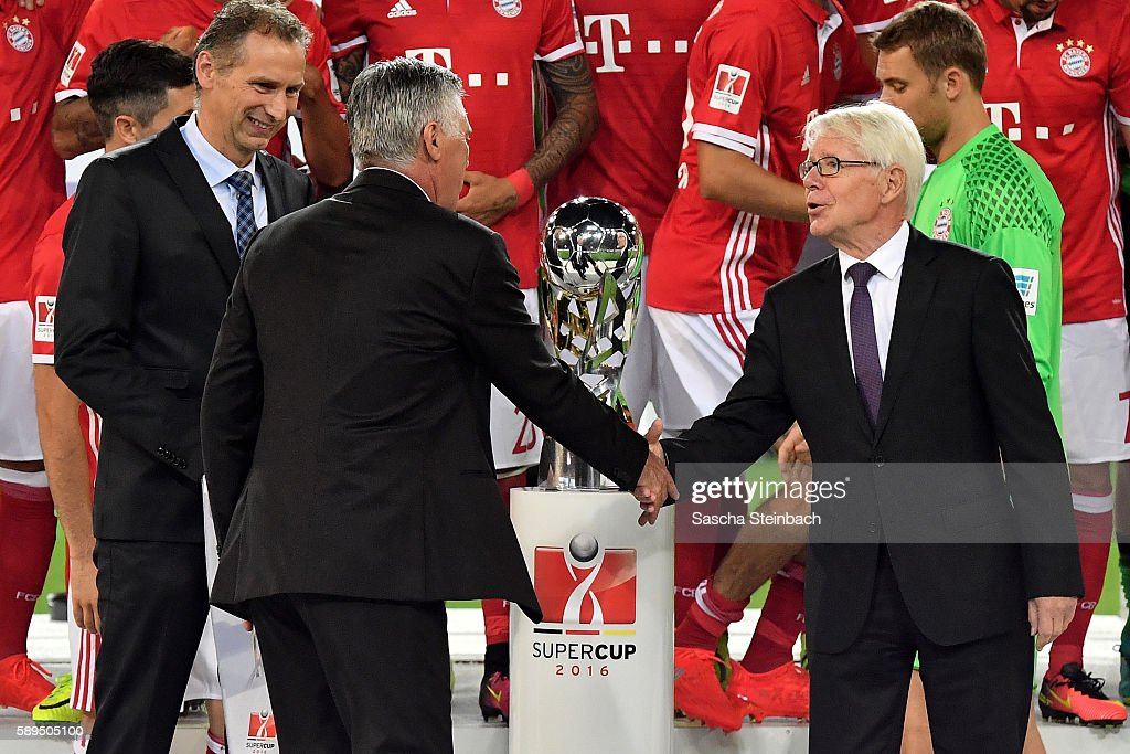 Head coach Carlo Ancelotti of Muenchen and President of the League Association DFL Dr Reinhard Rauball shake hands after the DFL Supercup 2016 match between Borussia Dortmund and FC Bayern Muenchen at Signal Iduna Park on August 14, 2016 in Dortmund, Germany.
