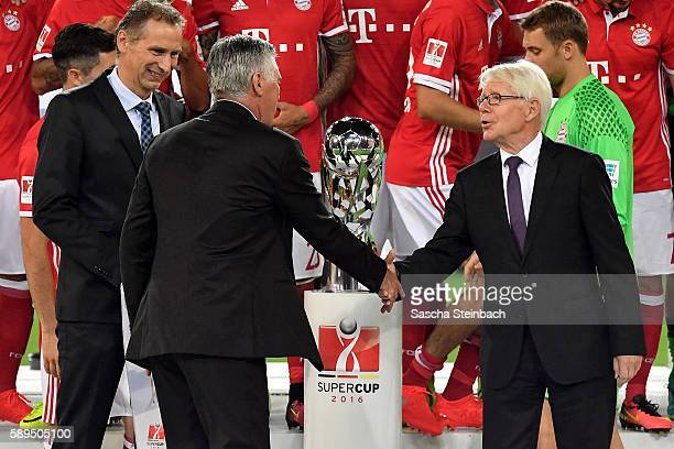 Head coach Carlo Ancelotti of Muenchen and President of the League Association DFL Dr Reinhard Rauball shake hands after the DFL Supercup 2016 match...