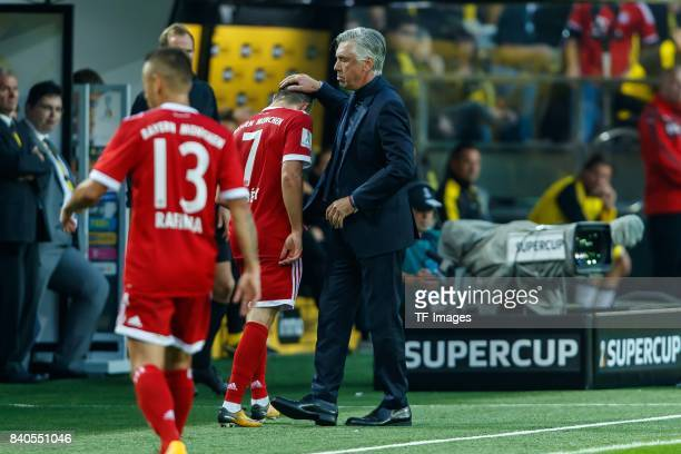 Head coach Carlo Ancelotti of Muenchen shakes hands with Franck Ribery of Muenchen during the DFL Supercup 2017 match between Borussia Dortmund and...