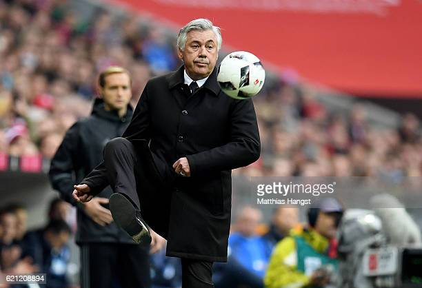 Head coach Carlo Ancelotti of Muenchen stops a ball during the Bundesliga match between Bayern Muenchen and TSG 1899 Hoffenheim at Allianz Arena on...