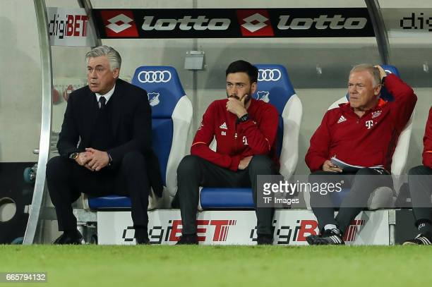 Head coach Carlo Ancelotti of Munich CoHead coach Davide AncelottiCoHead coach Hermann Gerland of Munich look on during the Bundesliga match between...