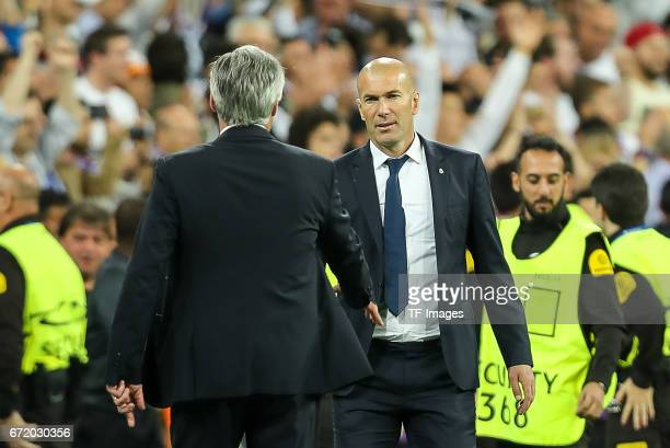 Head coach Carlo Ancelotti of Munich shakes hands with Head coach Zinedine Zidane of Real Madrid during the UEFA Champions League Quarter Final...