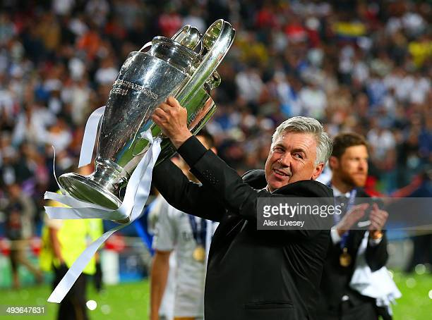 Head Coach, Carlo Ancelotti of Real Madrid celebrates with the Champions League trophy during the UEFA Champions League Final between Real Madrid and...