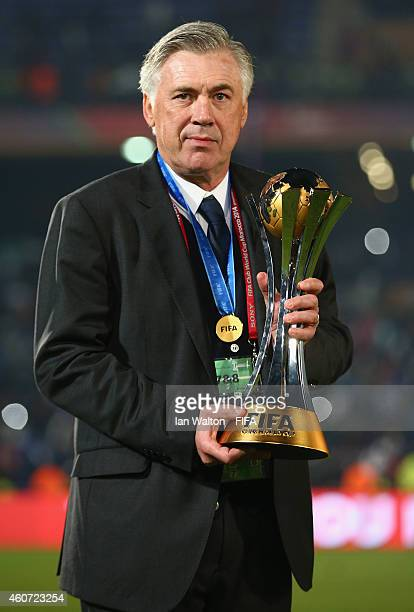 Head coach Carlo Ancelotti of Real Madrid celebrates with the trophy after the FIFA Club World Cup Final between Real Madrid and San Lorenzo at...