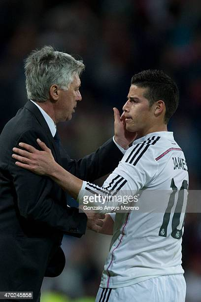 Head coach Carlo Ancelotti of Real Madrid CF caress his player James Rodriguez after the La Liga match between Real Madrid CF and Malaga CF at...