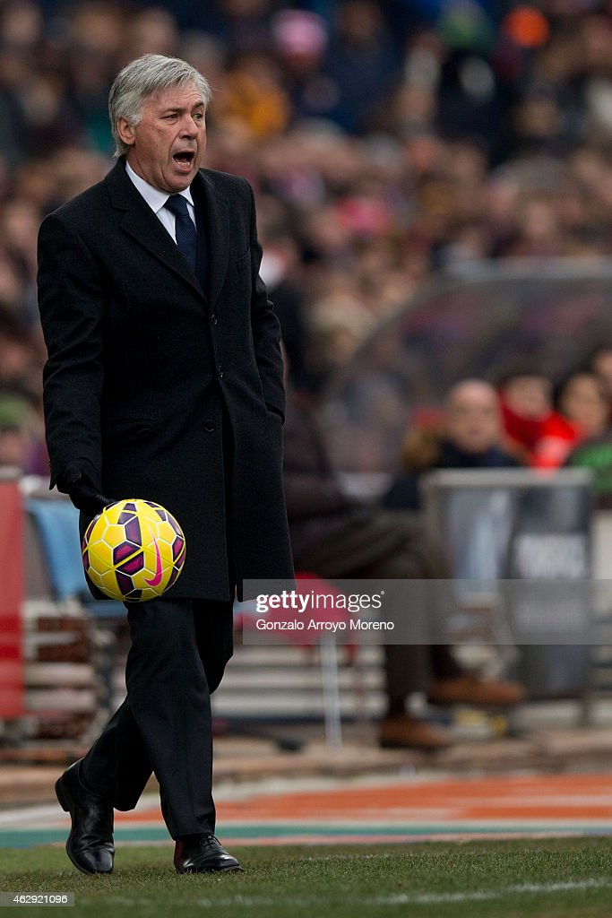 Head coach Carlo Ancelotti of Real Madrid CF holds the ball during the La Liga match between Club Atletico de Madrid and Real Madrid CF at Vicente Calderon Stadium on February 7, 2015 in Madrid, Spain.