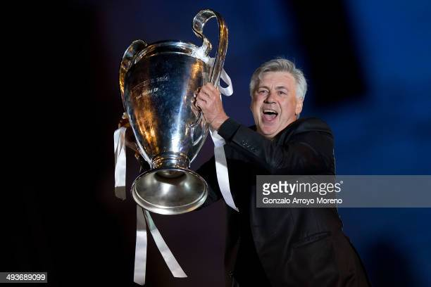 Head coach Carlo Ancelotti of Real Madrid CF holds the UEFA Champions League cup celebrating their victory on the UEFA Champions League Final match...
