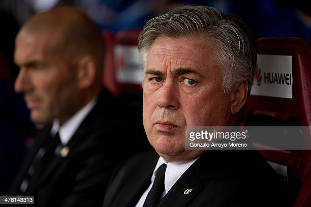 Head coach Carlo Ancelotti of Real Madrid CF looks on sitted on the bench close to assistant coach Zinedine Zidane prior to start the La Liga match...