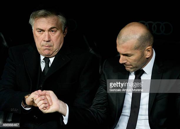Head coach Carlo Ancelotti of Real Madrid CF shake hands with his assistant coach Zinedine Zidane during the Copa del Rey semifinal first leg match...