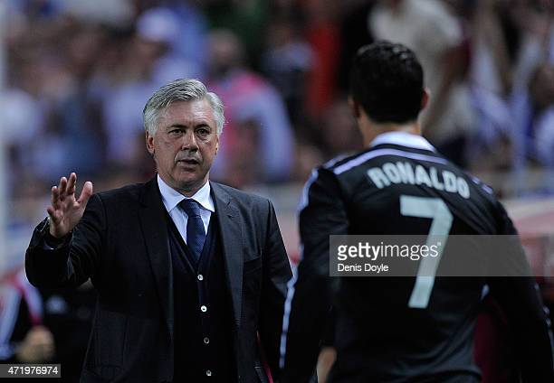 Head coach Carlo Ancelotti of Real Madrid congratulated Cristiano Ronaldo after Ronaldo scored his team's 3rd goal during the La Liga match between...