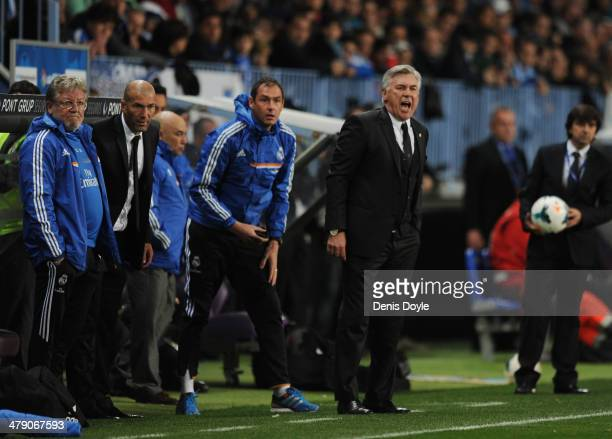 Head coach Carlo Ancelotti of Real Madrid gestures beside his assistants Paul Clement Zinedine Zidane and Giovanni Mauri during the La Liga match...