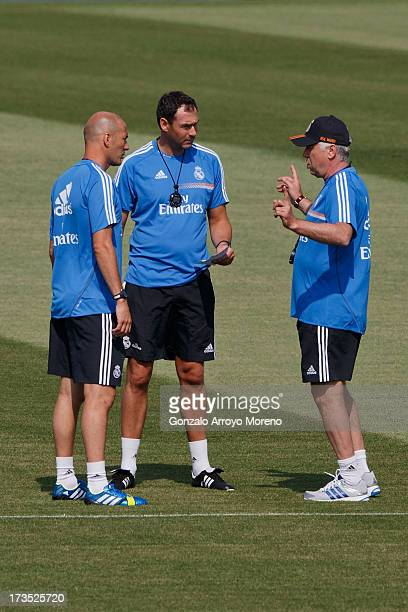 Head coach Carlo Ancelotti of Real Madrid gives instructions to assistant coach Paul Clement and Zinedine Zidane during a training session at the...