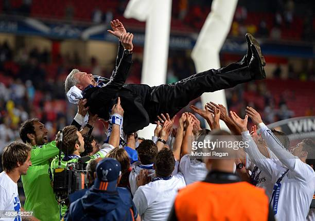 Head Coach Carlo Ancelotti of Real Madrid is lifted in celebration by his players during the UEFA Champions League Final between Real Madrid and...