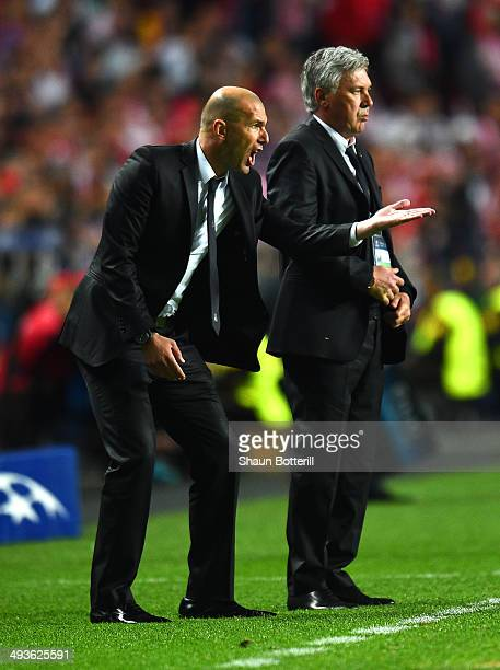 Head Coach Carlo Ancelotti of Real Madrid looks on as Assistant coach Zinedine Zidane of Real Madrid as he shouts instructions during the UEFA...
