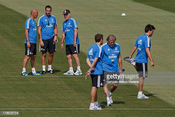 Head coach Carlo Ancelotti of Real Madrid looks on with assistant coach Paul Clement and Zinedine Zidane with other members of Real madrid technical...