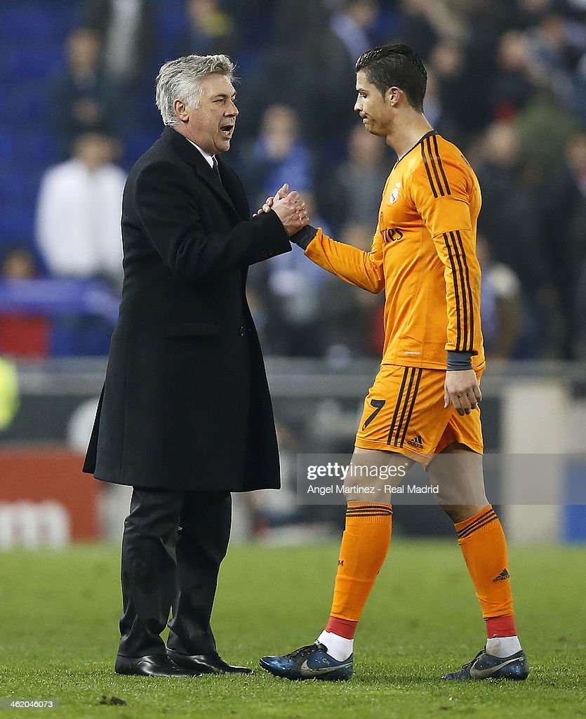 Head coach Carlo Ancelotti (L) of Real Madrid shakes hands with Cristiano Ronaldo at the end of the La Liga match between RCD Espanyol and Real Madrid at Cornella-El Prat Stadium on January 12, 2014 in Barcelona, Spain.