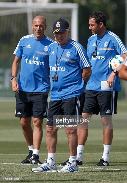 Head coach Carlo Ancelotti of Real Madrid with his assistants Zinedine Zidane and Paul Clemente during a training session at Valdebebas training...