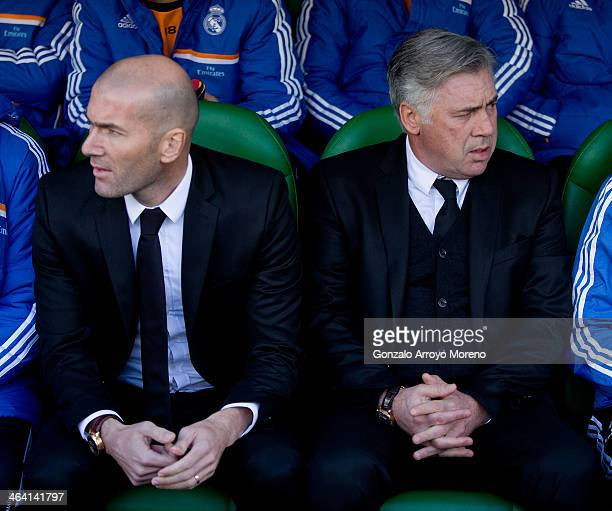 head coach Carlo Ancelotti R9 of Real Madrid CF and his assistant coach Zinedine Zidane looks on sitted on the bench prior to start the La Liga match...