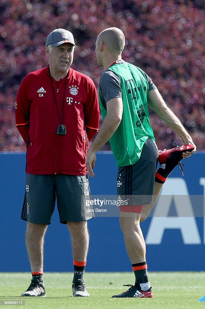 Head coach Carlo Ancelotti speaks to Arjen Robben during a training session at day 2 of the Bayern Muenchen training camp at Aspire Academy on January 4, 2017 in Doha, Qatar.