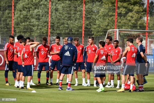 Head coach Carlo Ancelotti talks to his players before a training session at Saebener Strasse training ground on July 12 2017 in Munich Germany