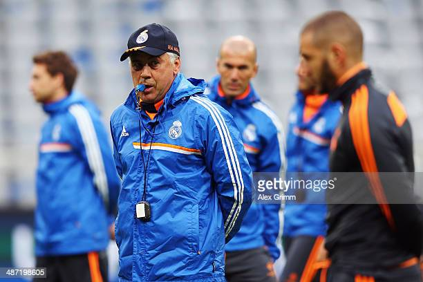 Head coach Carlo Ancelotti whistles during the Real Madrid training session ahead of their UEFA Champions League semifinal second leg match against...
