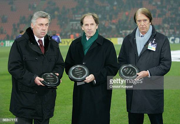 Head coach Carlos Ancelotti of Milan Franco Baresi and Cesare Maldini are awarded honorable players tributes before the UEFA Champions League Group E...
