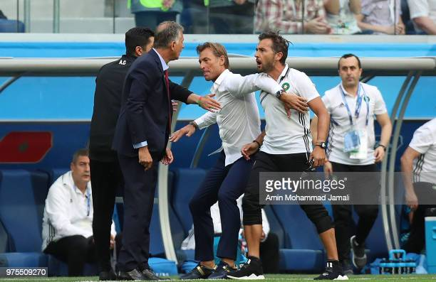 Head coach Carlos Queiro of Iran and head coach Herve Renard head of Morocco clash argue on the touchline during the 2018 FIFA World Cup Russia group...