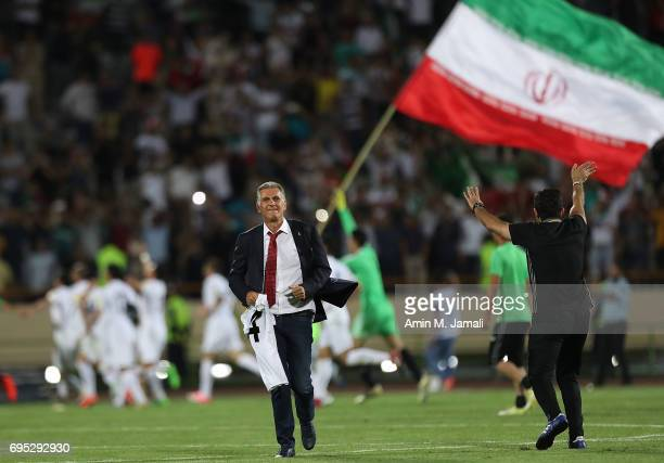 Head coach Carols Quieroz and players of Iran celebrate after the match during FIFA 2018 World Cup Qualifier match between Iran and Uzbekistan at...