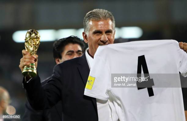 Head coach Carols Quieroz celebrate after the match during FIFA 2018 World Cup Qualifier match between Iran and Uzbekistan at Azadi Stadium on June...