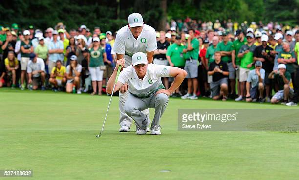 Head coach Casey Martin and Sulman Raza of Oregon line up a putt on the 19th hole of play during the final round of the 2016 NCAA Division I Men's...