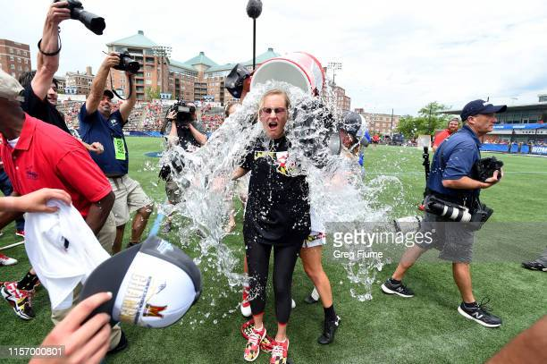 Head Coach Cathy Reese of the Maryland Terrapins is doused with water after a victory against the Boston College Eagles in the Division I Women's...