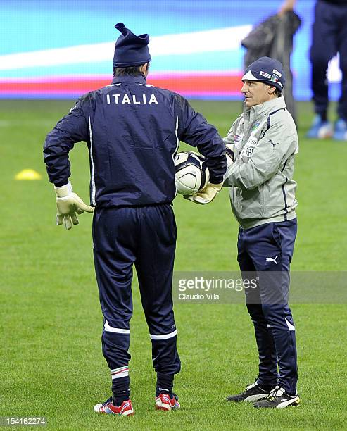 Head coach Cesare Prandelli and Gianluigi Buffon of Italy attend a training session ahead of their FIFA World Cup Brazil 2014 qualifier against...