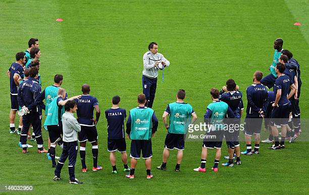 Head coach Cesare Prandelli of Italy talks to players during a UEFA EURO 2012 training session ahead of their Group C match against Spain at the...