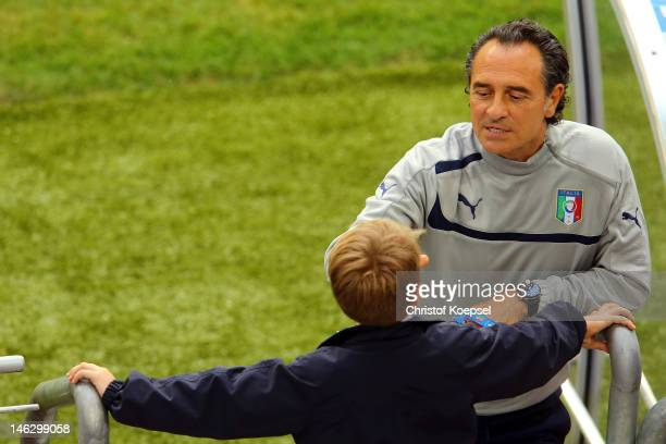 Head coach Cesare Prandelli of Italy talks to the son of her fiance Novella Benini during a UEFA EURO 2012 training session at the Municipal Stadium...