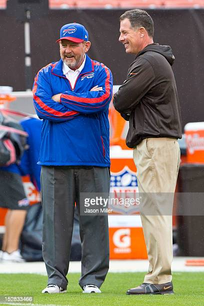 Head coach Chan Gailey of the Buffalo Bills talks with head coach Pat Shurmur of the Cleveland Browns prior to the start of the game at Cleveland...