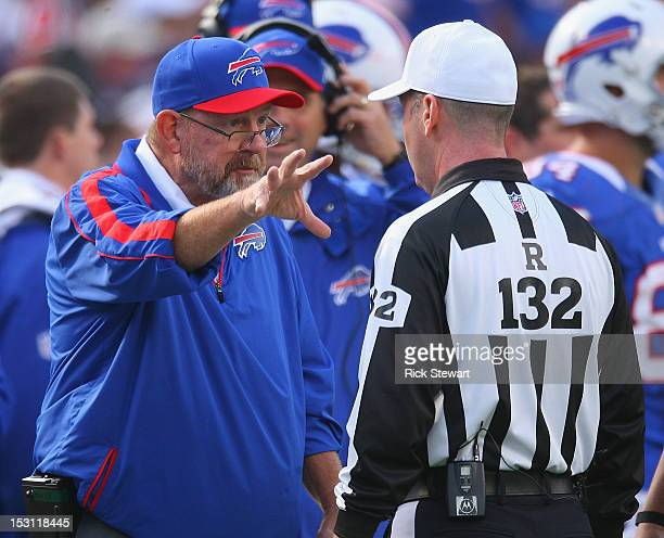 Head coach Chan Gailey of the Buffalo Bills talks with referee John Parry in the fourth quarter against the New England Patriots at Ralph Wilson...