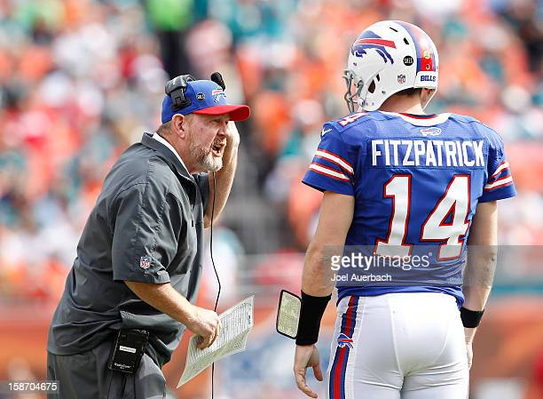 Head coach Chan Gailey talks to Ryan Fitzpatrick of the Buffalo Bills during a time out against the Miami Dolphins on December 23 2012 at Sun Life...