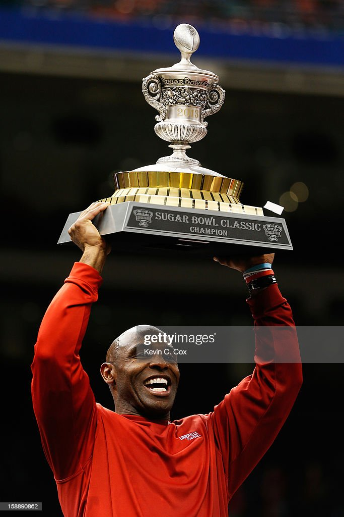 Head coach Charlie Strong of the Louisville Cardinals celebrates with the trophy after they defeated the Florida Gators 33 to 23 in the Allstate Sugar Bowl at Mercedes-Benz Superdome on January 2, 2013 in New Orleans, Louisiana.