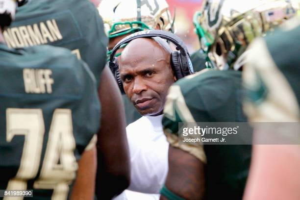 Head Coach Charlie Strong of the South Florida Bulls talks with his players during a timeout in the second quarter of their game against the Stony...