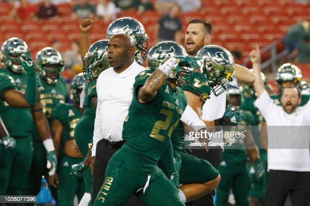 Head coach Charlie Strong of the South Florida Bulls tries to get his team fired up during pregame warmups before the start of the game against the...