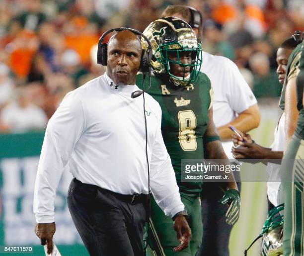 Head coach Charlie Strong of the South Florida Bulls walks on the sidelines during the game against the Illinois Fighting Illini at Raymond James...