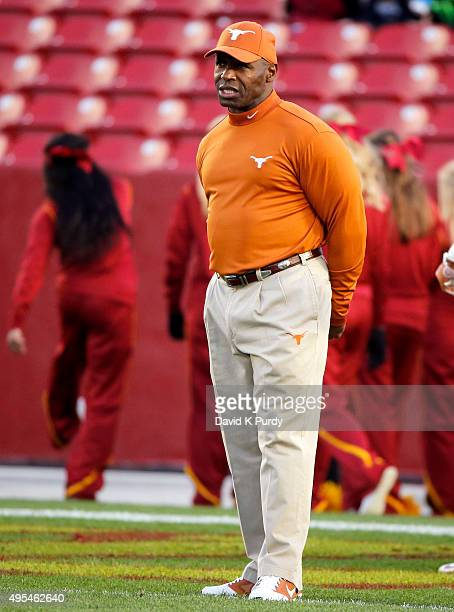 head coach Charlie Strong of the Texas Longhorns coaches during pregame warmups before taking on the Iowa State Cyclones at Jack Trice Stadium on...