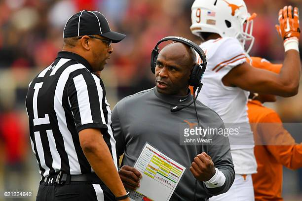 Head coach Charlie Strong of the Texas Longhorns discuss a call with an official during the first half of the game between the Texas Tech Red Raiders...