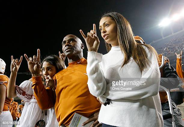 Head coach Charlie Strong of the Texas Longhorns sings 'The Eyes of Texas' with his daughters after being defeated by the TCU Horned Frogs 319 at...