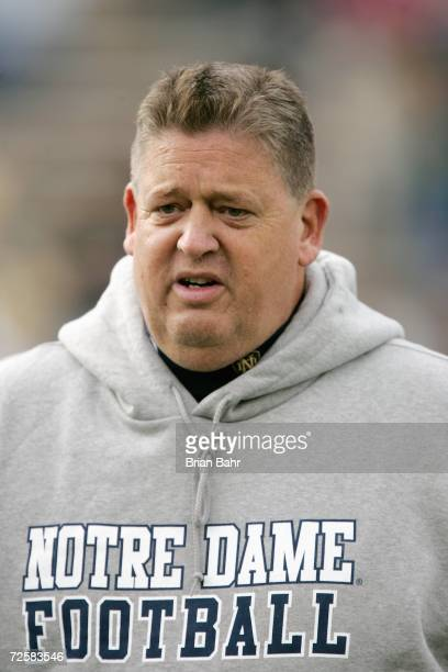 Head coach Charlie Weis of the Notre Dame Fighting Irish greets players on field before the game against the Air Force Falcons on November 11 2006 at...