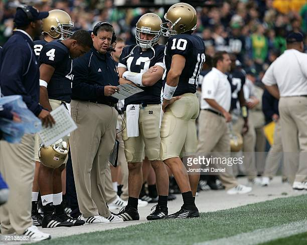 Head coach Charlie Weis of the Notre Dame Fighting Irish talks with Demetrius Jones, Evan Sharpley and Brady Quinn against the Purdue Boilermakers...