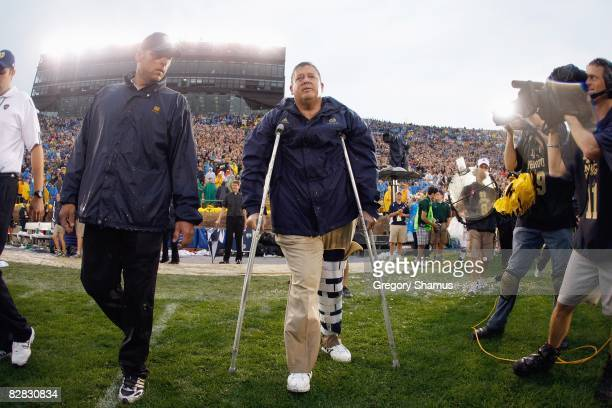 Head coach Charlie Weis of the Notre Dame Fighting Irish walks off the field after their 3517 victory over the Michigan Wolverines on September 13...