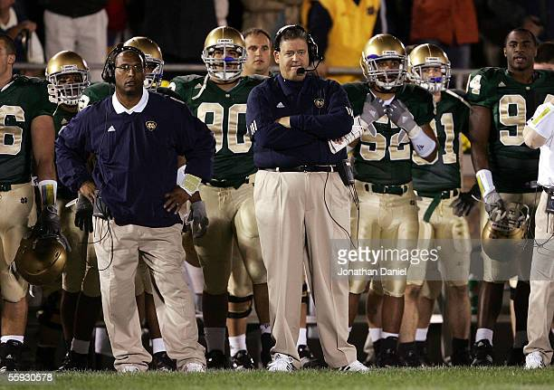 Head coach Charlie Weis of the Notre Dame Fighting Irish watches the end of a game against the University of Southern California Trojans with...