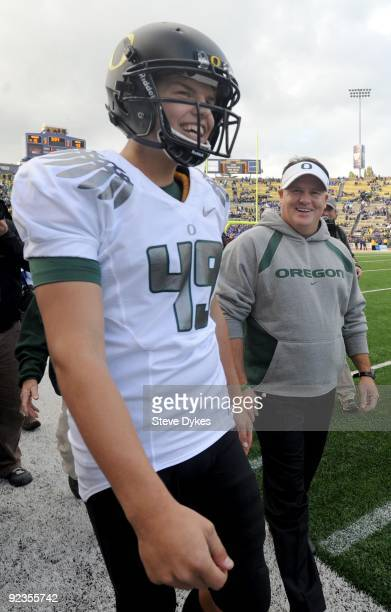 Head coach Chip Kelly and punter Jackson Rice of the Oregon Ducks smile as the clock ticks down in the fourth quarter of the game against the...