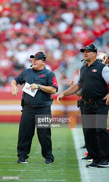 Head Coach Chip Kelly and Running Backs Coach Tom Rathman of the San Francisco 49ers stand on the sideline during the game against the Houston Texans...